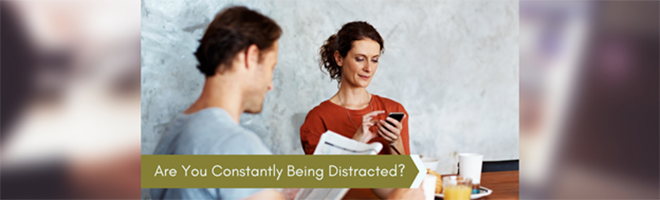 distracted couple on their mobile phones